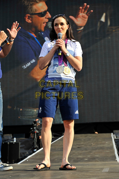 Victoria Pendleton.BT London Live, Hyde Park, London, England. .9th August 2012.full length white t-shirt blue shorts medal winner medals microphone .CAP/MAR.© Martin Harris/Capital Pictures.