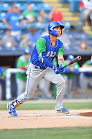Lexington Legends Jeison Guzman (7) swings at a pitch during a game against the Asheville Tourists at McCormick Field on July 1, 2019 in Asheville, North Carolina. The Tourists defeated the Legends 9-8. (Tony Farlow/Four Seam Images)