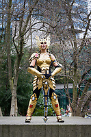 Beautiful Asian Woman Soldier in Suit of Golden Armor, Dani Moonstar Cosplay, Emerald City Comicon 2017, Seattle, WA, USA.