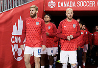 TORONTO, ON - OCTOBER 15: Tim Ream #13 and Michael Bradley #4 of the United States walk out to warm up during a game between Canada and USMNT at BMO Field on October 15, 2019 in Toronto, Canada.