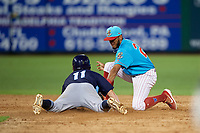 Clearwater Beach Dogs second baseman Daniel Brito (21) looks to tag Jake Palomaki (11) sliding in during a Florida State League game against the Charlotte Stone Crabs on July 26, 2019 at Spectrum Field in Clearwater, Florida.  Clearwater defeated Charlotte 6-5.  (Mike Janes/Four Seam Images)