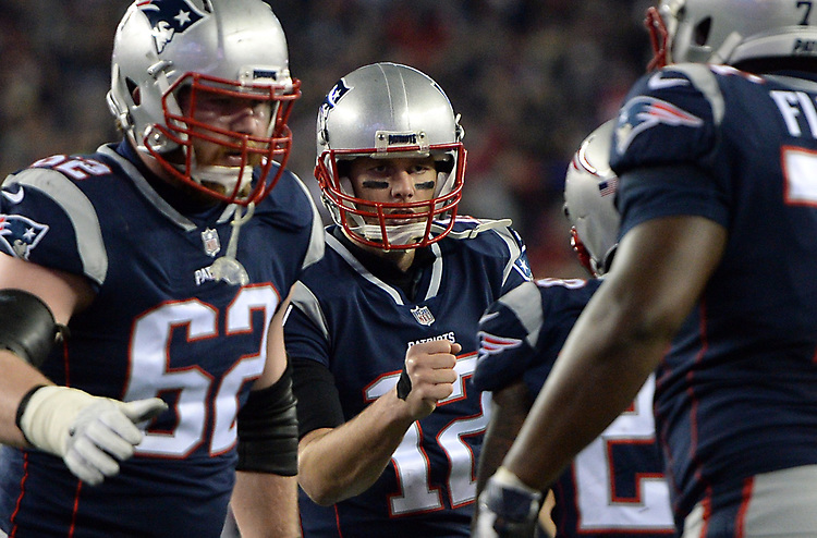 (Foxboro, MA, 01/21/18) New England Patriots quarterback Tom Brady, center, celebrates with Joe Thuney, left, James White, and Cameron Fleming (71) after scoring a touchdown against the Jacksonville Jaguars during the fourth quarter of the AFC championship NFL football game at Gillette Stadium on Sunday, January 21, 2018. Photo by Christopher Evans