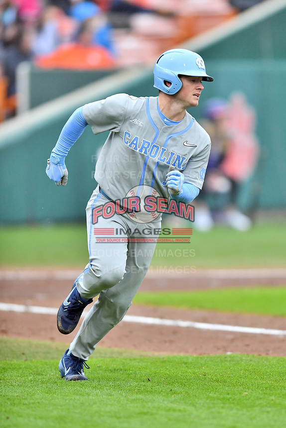 North Carolina Tar Heels center fielder Dylan Harris (3) runs to first base during a game against the Clemson Tigers at Doug Kingsmore Stadium on March 9, 2019 in Clemson, South Carolina. The Tigers defeated the Tar Heels 3-2 in game one of a double header. (Tony Farlow/Four Seam Images)