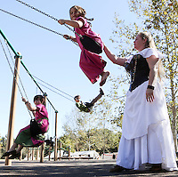 Oct. 31, 2015. Escondido,  CA. USA|Kate Lemieux swings her niece Kiki Lynch at the 16th Annual Escondido Renaissance Faire and Pirates in the Park held at Felicita Park Saturday .| Photos by Jamie Scott Lytle. Copyright.