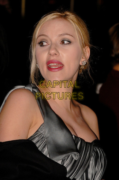 "SCARLETT JOHANSSON.""The Other Boleyn Girl"" Royal Film Premiere, Odeon Cinema, Leicester Square, London, England .19th February 2008..portrait headshot mouth funny looking over shoulder.CAP/IA.?Ian Allis/Capital Pictures"