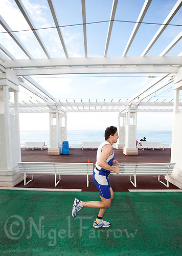24 APR 2011 - NICE, FRA - An age group competitor makes his way along the promenade during the Triathlon de Nice Cote d'Azur (PHOTO (C) NIGEL FARROW)
