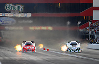 Jun. 15, 2012; Bristol, TN, USA: NHRA funny car driver Johnny Gray (left) races alongside Mike Neff during qualifying for the Thunder Valley Nationals at Bristol Dragway. Mandatory Credit: Mark J. Rebilas-