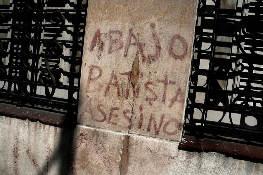 Havana (Cuba). September 2006..Centro La Habana. Grafftti against Dictator Batista..