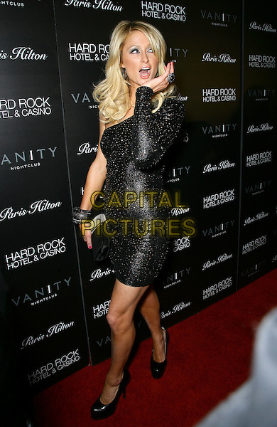 PARIS HILTON.Celebrates the Launch of ParisHilton.com at Vanity Nightclub inside the Hard Rock Hotel and Casino, Las Vegas, Nevada, USA, .16th January 2010..full length black one shoulder dress hand  ring studded studs clutch bag bracelets bangles platform shoes heels walking  .CAP/ADM/MJT.©MJT/Admedia/Capital Pictures