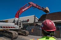 Hadler Company CEO George Hadler uses a backhoe to begin demolition of a large portion of Westerville Square Shopping Center to make way for the construction of a new WalMart store in the Columbus suburb. The store will approximately 108,000-square-feet, about half the  size of a traditional WalMart super store.