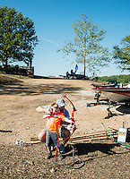 Brian Gueck (cq) with his son Trece Gueck (cq, age 5), practice shooting an arrow at a kids area during the U.S. Open Bowfishing Championship, Saturday, May 3, 2014. <br /> <br /> Photo by Matt Nager