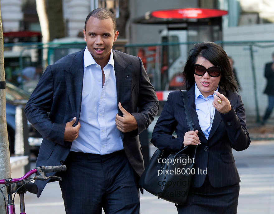 pic shows:  Phil Ivey arrives at court with Cheng Yin Sun    - also known as &quot;Kelly&quot;  today <br /> <br /> <br /> <br /> World's number one poker star Phil Ivey arrives at the High Court in London today 3.10.14<br /> He arrived with his legal team carrying bundles of papers in his case against Crockfords casino in Mayfair, London which is owned by Gentings.<br /> <br /> The high stakes gambler who is suing Britain&rsquo;s oldest gaming club for withholding his &pound;7.3million payout<br /> They claim he was &quot;edge counting&quot;<br /> <br /> He arrived with two women of Asian appearance who may be part of his legal team or involved in the case.<br /> <br /> <br /> <br /> <br /> <br /> <br /> Pic by Gavin Rodgers/Pixel 8000 Ltd