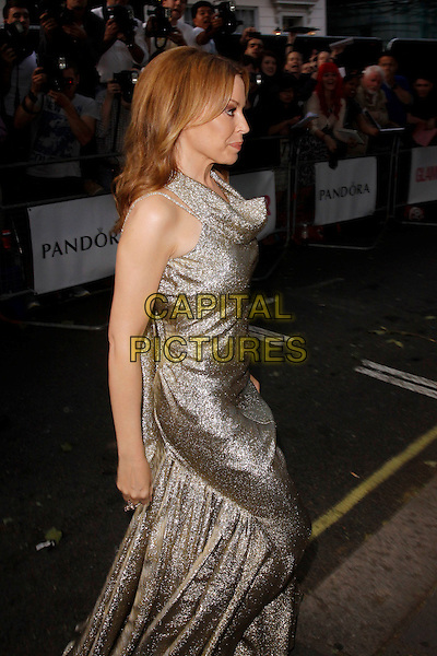 Kylie Minogue.Arrivals at the Glamour Women Of The Year Awards, Berkeley Square Gardens, London, England..May 29th, 2012.full length gold sparkly dress sleeveless profile side    .CAP/AH.©Adam Houghton/Capital Pictures.