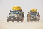 Chad (Tchad), North Africa, Sahara, Land Cruisers and drivers in sand storm, Borkou District