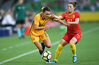 22 November 2017, Melbourne - HAYLEY RASO (16) of Australia and XU YANLU (21) of China PR fights for the ball during an international friendly match between the Australian Matildas and China PR at AAMI Stadium in Melbourne, Australia.. Australia won 5-1. Photo Sydney Low
