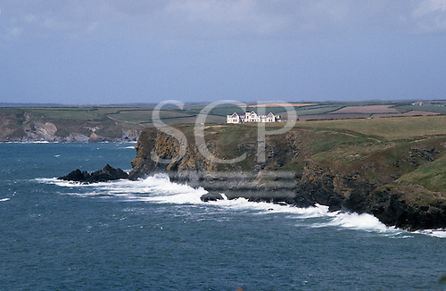 Cornwall, England. Marconi Point above Poldhu Cove with the Poldhu Hotel (now a nursing home) and the Marconi Monument.