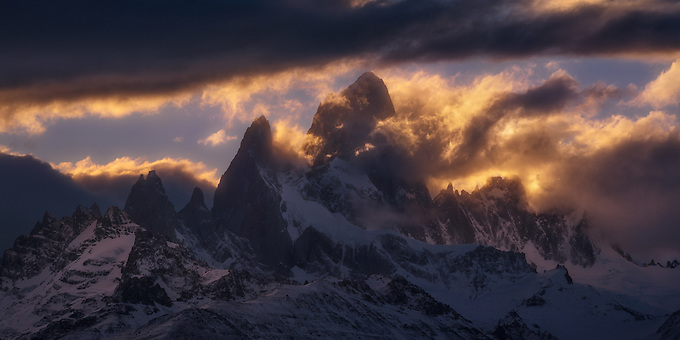 The sun sets behind Cerro Fitz Roy on a storm evening.