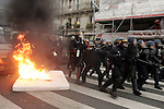 "France Student Clashes..French students and security forces clash on the ""place of the nation"" as students protest against the new CPE labor law in Paris, France, on saturday, March 18, 2006. The new law, that is designed to combat the high youth unemployment, is a permanent contract for those under 26, it allows employers to terminate employment at any moment within 2 years. ....The contrat premiere embauche (CPE), translated first employment contract, was a new form of employment contract pushed in spring 2006 in France by Prime Minister Dominique de Villepin. This employment contract, available solely to employees under 26, would have made it easier for the employer to fire employees by removing the need to provide reasons for dismissal for an initial ""trial period"" of two years, in exchange for some financial guarantees for employees. ....The law has met heavy resistance from students, trade unions, and left-wing activists, sparking protests in February and March 2006 (and continuing into April) with hundreds of thousands of participants in over 180 cities and towns across France"