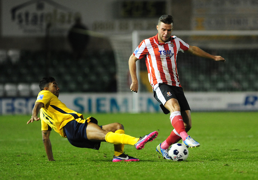 Lincoln City's Dan Gray vies for possession with Woking's Kevin Betsy ..Football - Blue Square Premier - Lincoln City v Woking - Tuesday 4th December 2012 - Sincil Bank - Lincoln..