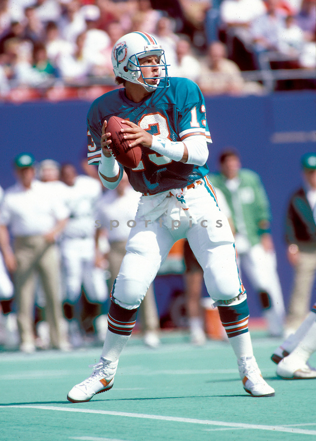 Miami Dolphins Dan Marino (13) in action during a game against the New York Jets on September 21, 1986 at Giants Stadium in East Rutherford, New Jersey. The Jets beat the Dolphins 51-45.  Dan Marino played for 17 years all with the Dolphins and was a 9-time Pro Bowler and was inducted to the Pro Football Hall of Fame in 2005.