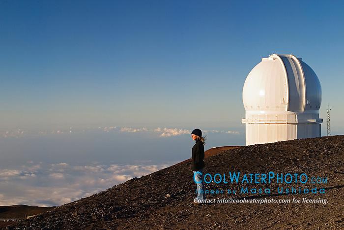 Woman and Canada-France-Hawaii Telescope or CFHT, Mauna Kea Observatories, Big Island, Hawaii
