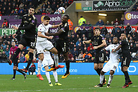 Wes Morgan of Leicester City heads the ball clear from Federico Fernandez of Swansea City during the Premier League match between Swansea City and Leicester City at The Liberty Stadium, Swansea, Wales, UK. Saturday 21 October 2017