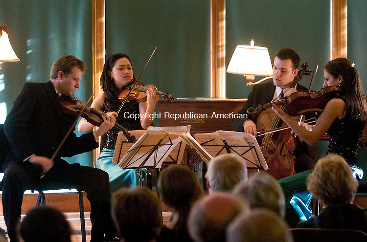 NORFOLK, CT- 06 FEBRUARY 2005-020605JS01--Members of the Biava String Quartet, from left Austin Hartman; Hyunsu Ko; Jacob Braun and Mary Persin perform Beethoven's String Quartet in C Major, Opus 49 No. 3 during a performance at the Battell House Concert Hall Sunday in Norfolk. The concert was the final in the Norfolk library's three-part concert series. Procedes from Sunday's performance will benefit the Norfolk Library and Norfolk Ambulance.   -- Jim Shannon Photo--Biava String Quartet; Austin Hartman; Hyunsu Ko; Jacob Braun; Mary Persin; Norfolk; Battell House Concert Hall are CQ