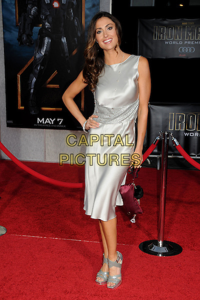 """KATIE CLEARY .""""Iron Man 2"""" World Premiere held at the El Capitan Theatre, Hollywood, California, USA, 26th April 2010..arrivals full length silver dress sleeveless hand on hip shiny open toe grey gray patent sandals clutch bag red .CAP/ADM/BP.©Byron Purvis/AdMedia/Capital Pictures."""