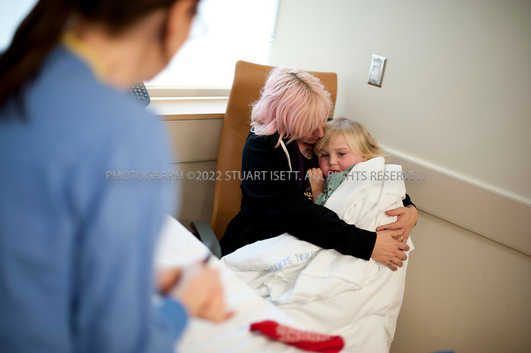 2/15/2012--Seattle, WA, USA..Lynn Gosnell, (45) comforts her 4 year old son, Henry, in the Dental Surgery Center at the Center for Pediatric Dentistry in Seattle, WASH., a joint center run by the Seattle Children's Hospital and the University of Washington to provide dental services to children and infants. Henry had just woken up after having multiple cavities repaired while under a general anesthetic....©2012 Stuart Isett. All rights reserved.