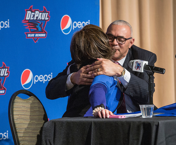 Athletics director Jean Lenti Ponsetto, left, and Dave Leitao hug as he is introduced as the new head coach of Depaul University's men's basketball program during a press conference Monday, March 30, 2015, at the university's Lincoln Park Campus. (DePaul University/Jamie Moncrief)