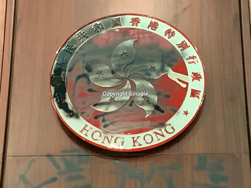 The defaced emblem of Hong Kong inside the chamber. Mostly student and youth demonstrators break into the Hong Kong's Legislative Council Chamber 1st July 2019. The protestors caused widespread damage and are demonstrating against the extradition bill, since suspended, that was being pushed through the Hong Kong Council.