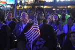 Illinois delegates watch a video presentation on Barack Obama's life on the floor of the Democratic National Convention at the Pepsi Center in Denver, Colorado on August 25, 2008.