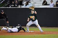 Siena Saints infielder Brian Fay (28) waits for a pick off attempt throw as James Vasquez (13) dives back to first during the opening game of the season against the UCF Knights on February 13, 2015 at Jay Bergman Field in Orlando, Florida.  UCF defeated Siena 4-1.  (Mike Janes/Four Seam Images)