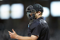 Home plate umpire Travis Godec checks his indicator during the International League game between the Toledo Mud Hens and the Charlotte Knights at BB&T BallPark on April 23, 2019 in Charlotte, North Carolina. The Knights defeated the Mud Hens 11-9 in 10 innings. (Brian Westerholt/Four Seam Images)