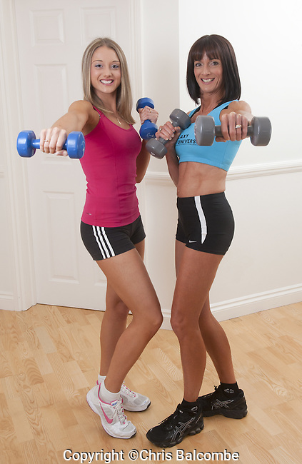 SUN FEATURES:..Mum to compete against 17 year-old daughetr in body-building contest...Mum Jacqueline with daughter Poppy, 17, in their body-building outfits, with weights, alone and together, at their home near Bognor Regis, Sussex.<br /> Pic: Chris Balcombe....07568 098176..Office: 023 80 849187