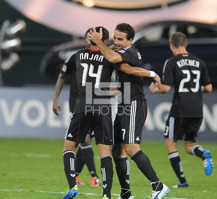 D.C. United forward Dwayne De Rosario (7) celebrates with teammate Andy Najar (14) his third goal in the 31th minute of the game.  D.C. United defeated Real Salt Lake 4-0 at RFK Stadium, Saturday September 24 , 2011.