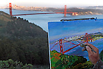 An artist paints the scene of the Golden Gate Bridge California.