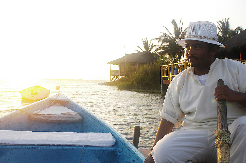 An employee rows guests across the estuary at the Hotelito Desconocido,  an extremely luxurious eco-friendly hotel on Costalegre, Jalisco, Mexico