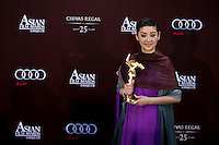 HONG KONG - MARCH 21:  Chinese actress Xu Fan poses backstage after winning the Best Actress Award for her role at the 'Aftershock' at the 5th Asia Film Awards ceremony at the Convention and Exhibition Centre on March 21, 2011 in Hong Kong, China.  Photo by Victor Fraile / studioEAST