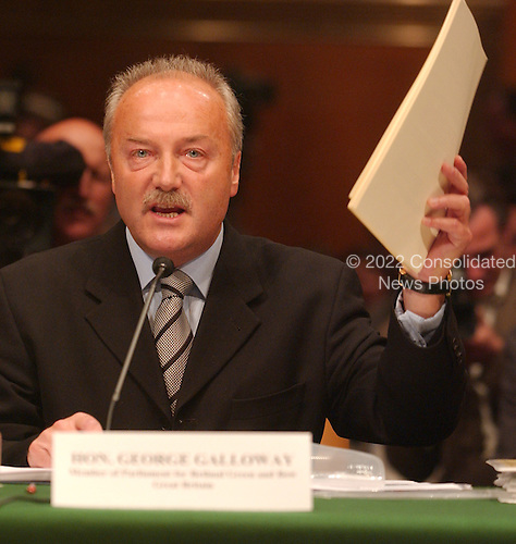 "Washington, D.C. - May 17, 2005 -- George Galloway , Member of Parliament for Bethnal Green and Bow, Great Britain, testifies before the United States Senate Committee on Homeland Security and Governmental Affairs Permanent Subcommittee on Investigations hearing on ""Oil For Influence: How Saddam Used Oil to Reward Politicians Under the United Nations Oil-for-Food Program"" in Washington, D.C. on May 17, 2005.  .Credit: Ron Sachs / CNP"