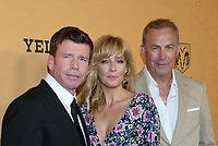 LOS ANGELES, CA - JUNE 11: Taylor Sheridan, Kelly Reilly, Kevin Costner, at the premiere of Yellowstone at Paramount Studios in Los Angeles, California on June 11, 2018. <br /> CAP/MPI/FS<br /> &copy;FS/MPI/Capital Pictures