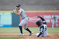 Cristian Pache (15) of the Gwinnett Stripers is forced out at second base by Mandy Alvarez (24) of the Scranton/Wilkes-Barre RailRiders at Coolray Field on August 18, 2019 in Lawrenceville, Georgia. The RailRiders defeated the Stripers 9-3. (Brian Westerholt/Four Seam Images)