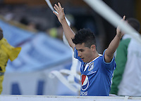 BOGOTÁ -COLOMBIA, 09-02-2014. Omar Vasquez de Millonarios celebra un gol en contra del Atlético Nacional durante partido por la fecha 4 de la Liga Postobón  I 2014 jugado en el estadio Nemesio Camacho el Campín de la ciudad de Bogotá./ Omar Vasquez of Millonarios celebrates a goal  against Atletico Nacional during for the 4th date of the Postobon  League I 2014 played at Nemesio Camacho El Campin stadium in Bogotá city. Photo: VizzorImage/ Gabriel Aponte / Staff