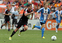 WASHINGTON, D.C. - AUGUST 19, 2012:  Chris Pontius (13) of DC United runs past Brian Carroll (7) of the Philadelphia Union during an MLS match at RFK Stadium, in Washington DC, on August 19. The game ended in a 1-1 tie.