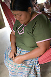 Maria Ack weaves baskets in her home in the Mayan community of San Miguel, Toledo, Belize