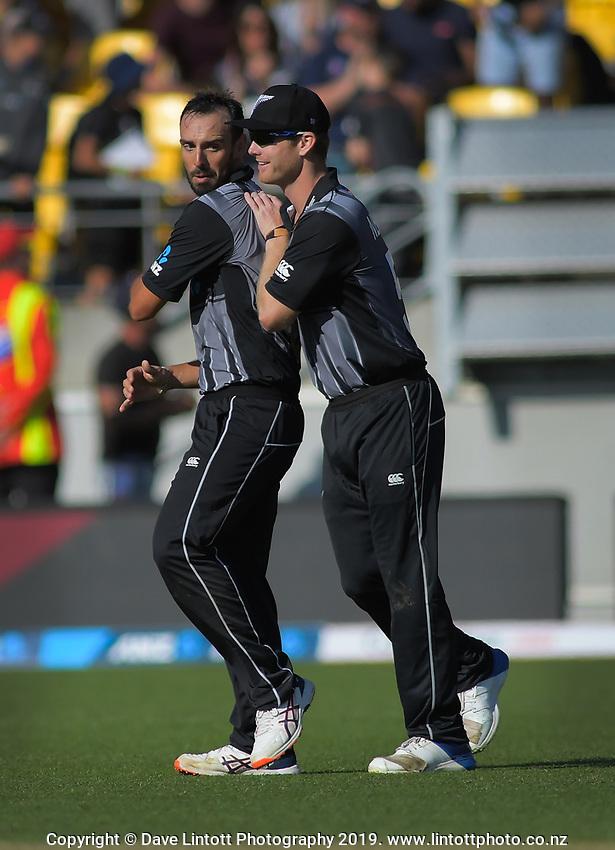 NZ's Jimmy Neesham (right) congratulates Daryl Mitchell on taking the final wicket. Twenty20 International cricket match between NZ Black Caps and England at Westpac Stadium in Wellington, New Zealand on Sunday, 3 November 2019. Photo: Dave Lintott / lintottphoto.co.nz