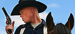 Stephan Roy of the Mounted Color guard out of Fort Carson, Co listens to instructions before the mounted pistol competition at TT&T Ranch north of Cheyenne Thursday afternoon.  Roy was one of over 100 participants in the 2008 Annual Bivouac and National Cavalry Competition.  Michael Smith/staff