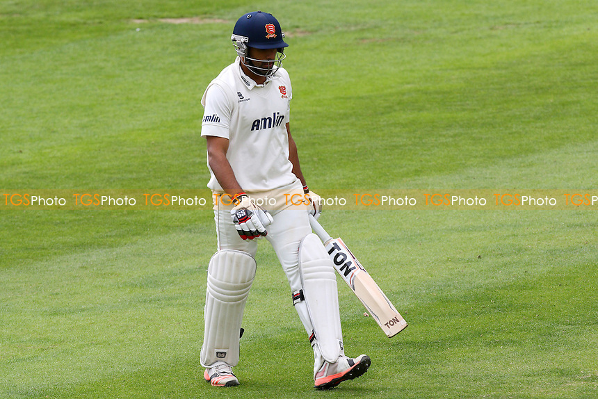 Ravi Bopara of Essex CCC leaves the field having been dismissed
