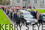 Donal O'Callaghan funeral leave St Marys Cathedral on Monday morning the coffin flanked by guards of honour from Dr Crokes GAA club, Killarney Celtic FC and the Killarney Vintners