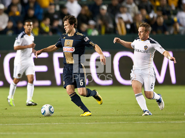 CARSON, CA – April 2, 2011: Philadelphia Union midfielder Stefani Miglioranzi (6) moves the ball away from LA Galaxy Chris Birchall (8) during the match between LA Galaxy and Philadelphia Union at the Home Depot Center, March 26, 2011 in Carson, California. Final score LA Galaxy 1, Philadelphia Union 0.